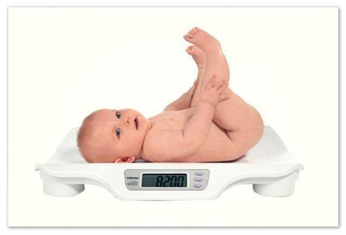 Малыш на весах.